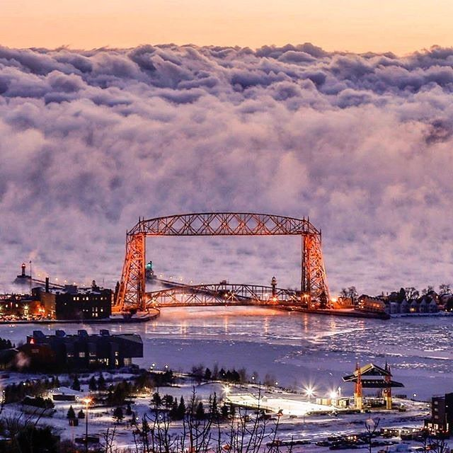 Amazing photo of sea smoke (fog) rising off of Lake Superior behind the Aerial Lift Bridge in Duluth, Minnesota, by (at)muddman4809 via Instagram.