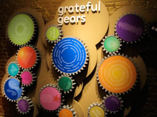 donor recognition art installation; each gear represents a different level of giving