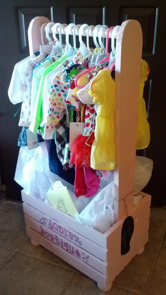 """Little Girls Dress Up Box: Four Ball Finials, 1 Wooden Crate, 1 Clothes Size Dowel Rod, 2 - 36"""" 1x4s, Woodfiller, Wood Screws, Sandpaper, Primer and Spraypaint.  Approximately $30 DIY"""
