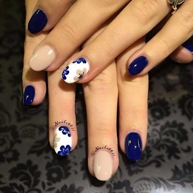Here's a cool floral design by @nailit411 using Dazzle Dry's Nocturnal Blue, Sentimental and White Lightning.  _____________________ To buy Dazzle Dry colors, please go to: IG: @dazzledry FB: Dazzle Dry Quick-Dry Nail Polish #nailsofintagram #nailporn #polishlicious #nailartwow #nailsoftheday #nailartlovers #diy #hobby #nailsdid #nailsbyme #omgpolish
