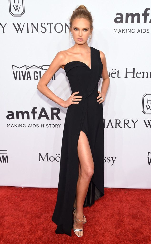 Romee Strijd from amfAR Gala 2016 Red Carpet Arrivals  The Victoria's Secret Angel was a beauty in a black asymmetrical gown finished off with a top knot.