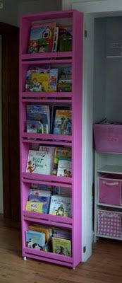 DIY instructions for storage built into the back of the closet door- GENIUS! (Caster wheels on the bottom for support) Could always use more book space...or someone could buy me a Kindle Fire (hint hint)
