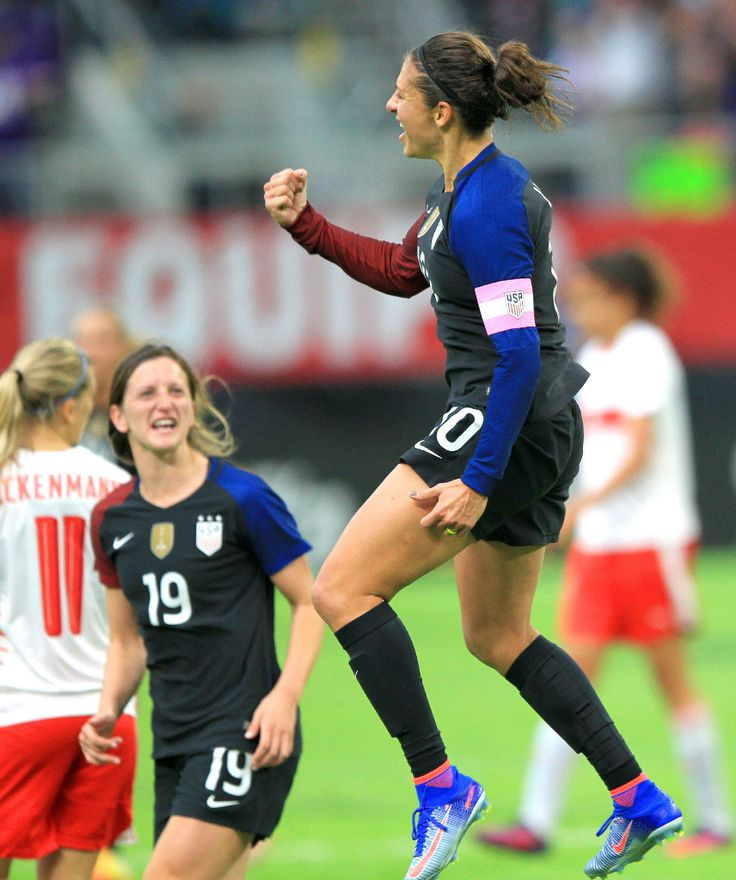 Carli Lloyd vs. Switzerland, Minneapolis, Oct. 23, 2016. In the background is Andi Sullivan. (Andy Clayton-King/AP)