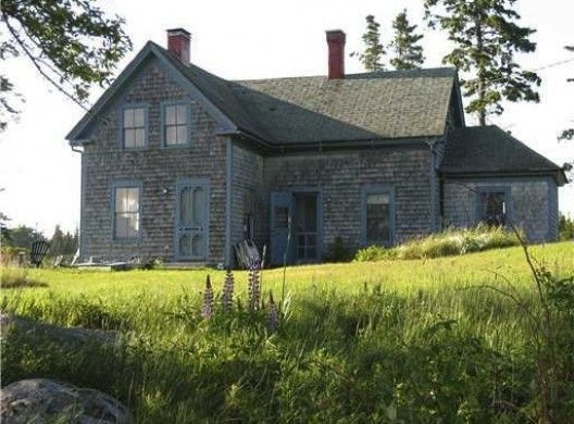 From the Atlantic.com ~ Yes, there's no doubt this is located in a seriously remote location -- the nearly five-hour trip from Boston includes a long ferry ride -- but one would be hard pressed to find a more charming seaside retreat than this weathered farmhouse. Built in the 1880s, the shingled manse occupies a boulder-strewn six acres, with 1,500 feet of waterfront and broad views over Hurricane Sound and the Basin. The interiors are the very epitome of rustic Maine living.