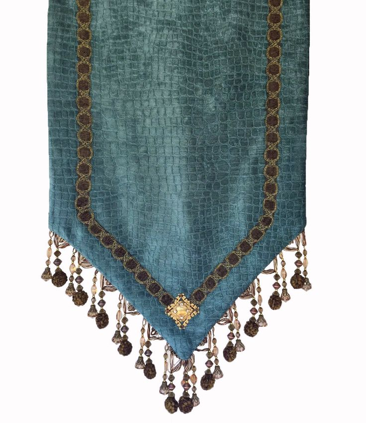Our turquoise croc chenille table runner is accented with oversized beads, decorative trims, and jeweled embellishment. It makes a statement in almost any setting.