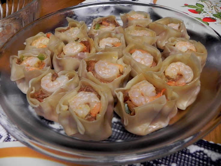 Siomai - is steamed with either ground pork, beef or shrimp,combined with extenders like green peas, carrots and the like which is then wrapped in wonton wrappers. It is normally dipped in soy sauce and squeezed calamansi (lime) and for some, with an oily, spicy garlic mix.