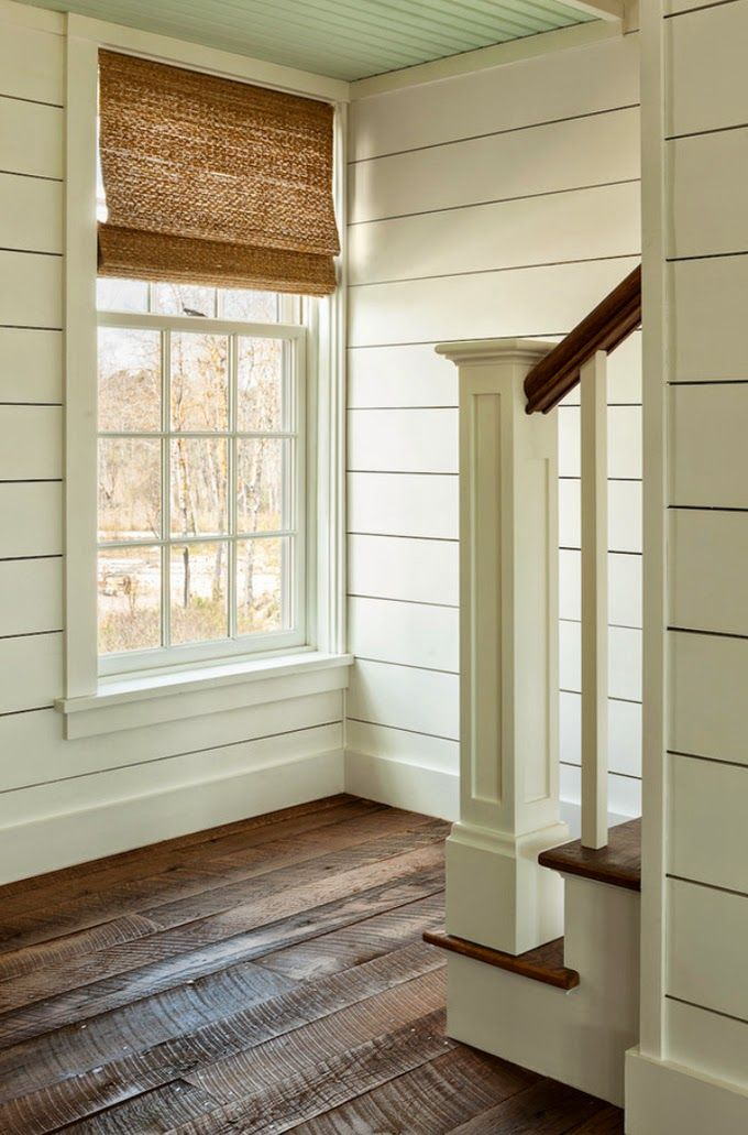 Planked Stairwall, wide baseboards, simple moulding, rustic floor (maybe smoother finish for less stubbed toes....) But I love those long windows!