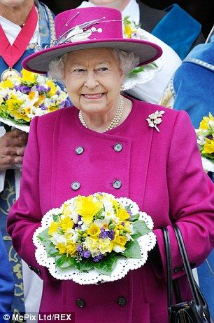 Glamorous: The Queen looked wonderful in cerise Stewart Parvin 4/17/2014