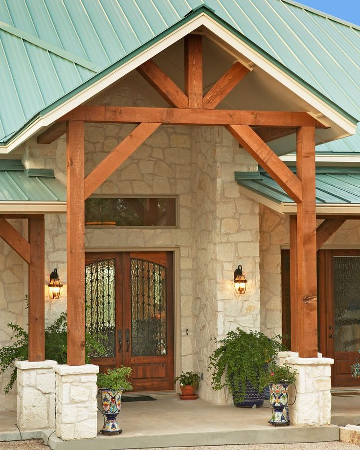 Lovely Front Home Entrance Design With Native Texas Limestone Cedar Beams And Green Metal Roof Austin Custom Builder