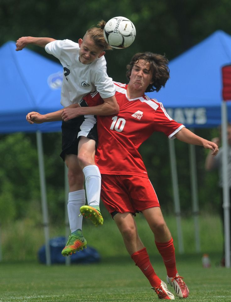 Gilbert's Cael Klein heads the ball away from Davenport Assumption's Sam Moore during the second half of Assumption's 2-1 victory in a Class 1A state semifinal on Friday at Cownie Soccer Complex in Des Moines. Photo by Nirmalendu Majumdar/Ames Tribune http://www.amestrib.com/sports/20170602/boys8217-soccer-gilbert-falls-2-1-in-state-semifinal-against-assumption