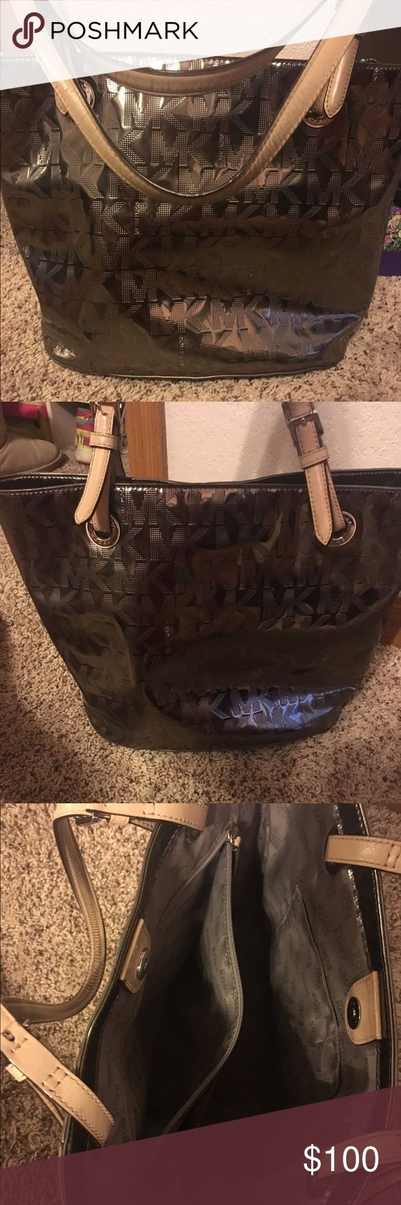 Michael Kors Metallic Handbag Purchased for $195 and have only used occasionally. This bag has been kept in very good condition only showing a slight amount of wear on the handles. Michael Kors Bags Shoulder Bags