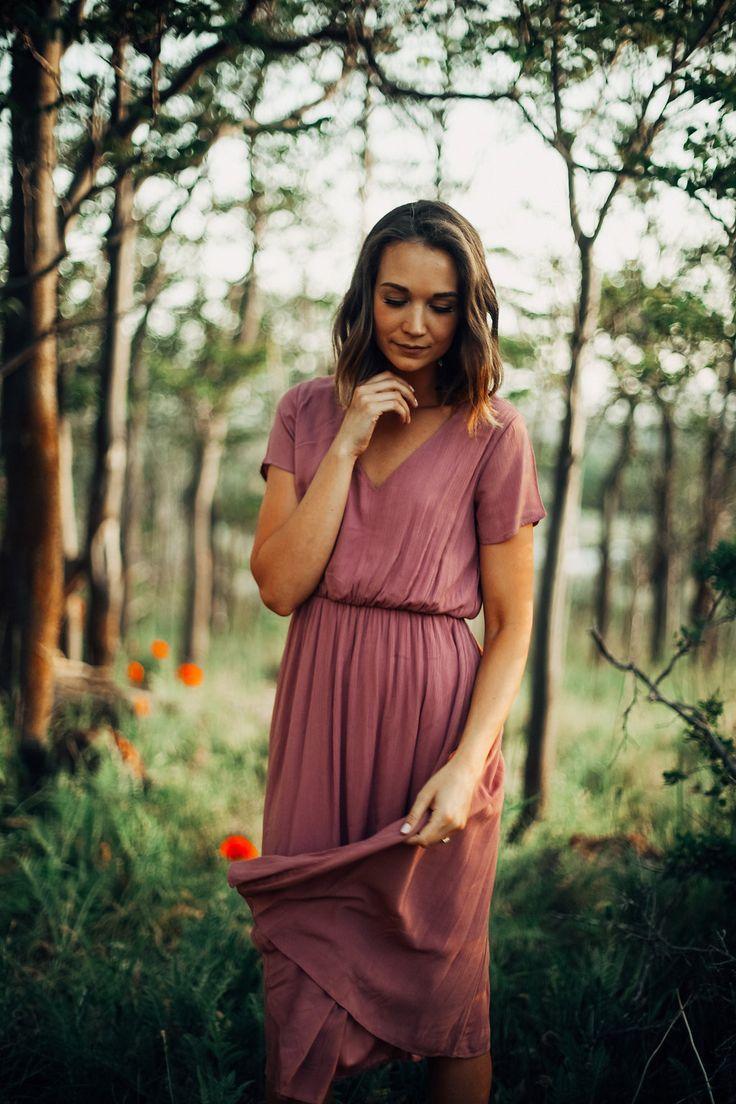 Model in woods wearing derby dress