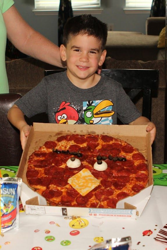 Angry Birds party -- pizza bird made with 1 hard boiled egg, olives and a slice of cheese!