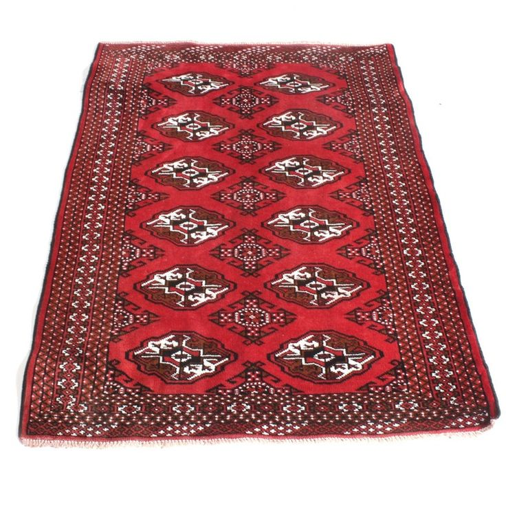 Small hand knotted wool Persian Turkeman accent rug. Rectangular red field populated by diamond-shaped and oval guls in a palette of scarlet and cream. Field framed by a compound geometric border, and the far ends have close-cropped natural warp fringe