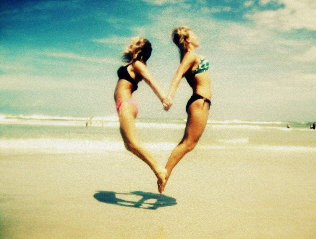 jump up and make a heart! A new beach pose for you, Sarah and Rebecca!