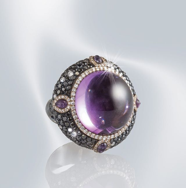 Cabochon amethyst, black and white diamonds, gold and black rhodium.