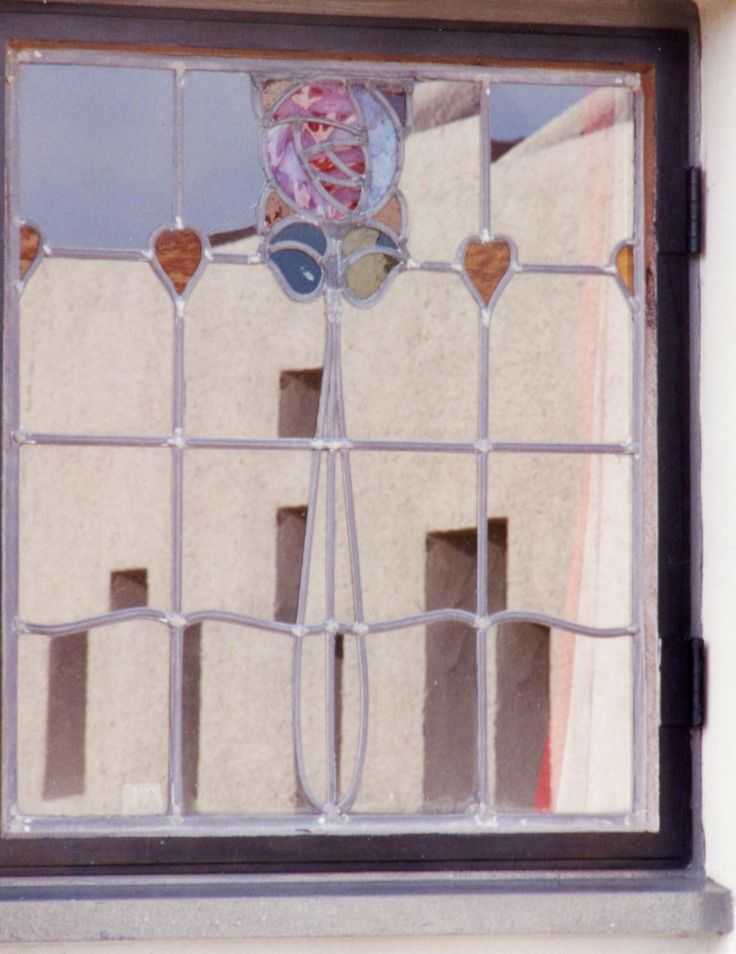 The Artist's Cottage, (CRM's An Artist's Cottage and Studio) was built in 1992 near the village of Farr by Inverness. East-facing bedroom window showing a pattern of relections from the garage