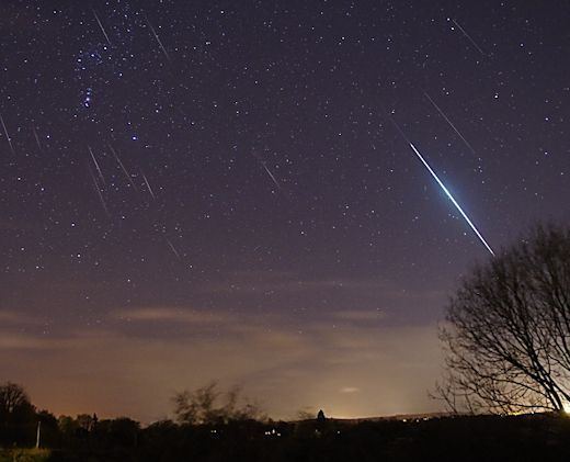 """http://www.spaceweather.com/ THE GEMINID METEOR SHOWER:   Pete Glastonbury sends this report from Devizes, Wiltshire, UK: """"The weather forecast called for clouds. I'm glad it was wrong! I witnessed a stunning display with many bright meteors."""" He created this composite of all the Geminids he saw on Dec. 14th between midnight and sunrise."""