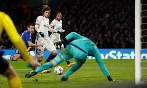 Paris Saint-Germains Adrien Rabiot settles to his task for now