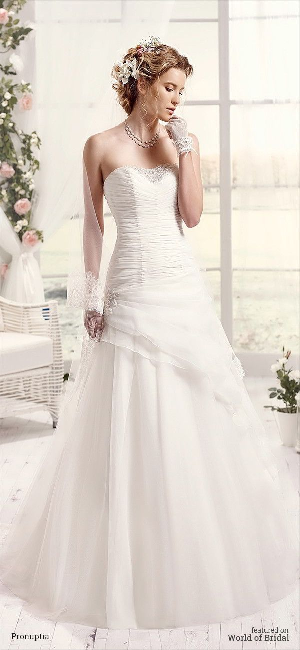 Tulle wedding dress, strapless draped long to end, fancy neckline with rhinestones, lace application strassée on the side skirt with overskirt draped vaporous volume for soft and romantic wedding at once.