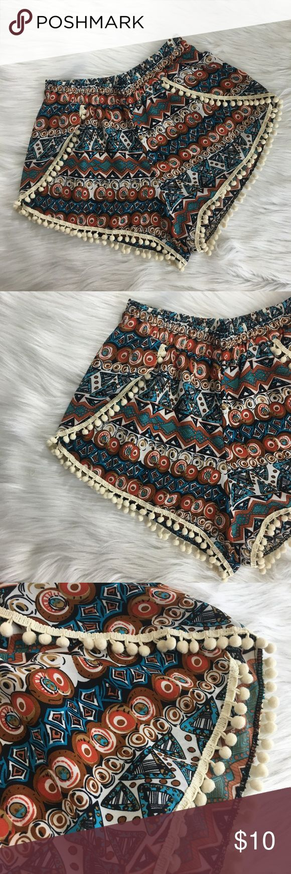 "Pom Pom tribal shorts Size: S Type: Pom Pom tribal shorts Details: no pockets, elastic waistline   Waist measurement: 12"" across  Inseam: 2"" Length: 10"" Material: 100% polyester Condition: preloved, ‼️Flawed item: priced accordingly‼️ *see 5th pic for rip/tear in the elastic waistline, exposing elastic (can be fixed by sewing) Shorts"