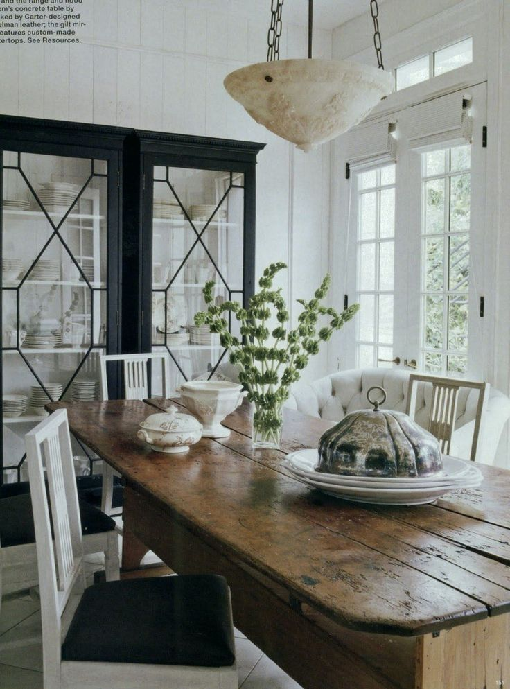 20 Great Shades of White Paint and Some To Avoid | fabulous black and white dining room by Darryl Carter - wonderful farmhouse antique dining table | white walls |Gustavian dining chairs | Adore the black and white fretwork china cabinet architecture by D