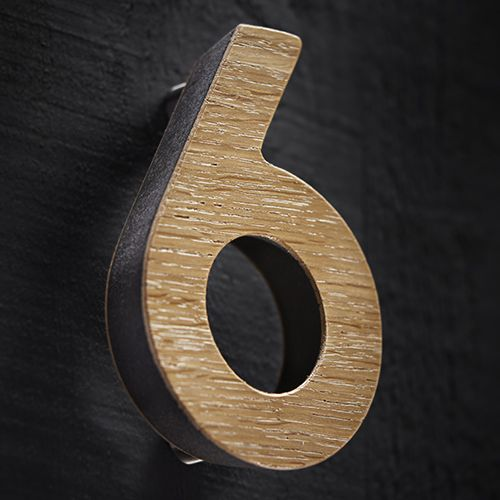 The Holt numerals are crafted in the UK from FSC accredited oak and then precision finished with 15% matt exterior lacquer. Durable steel components are inserted into the numerals to provide the base strength for the secret face fixings.