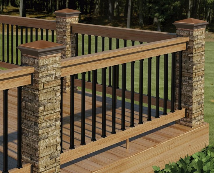 Deck Skirting Ideas and Designs | This beautiful deck railing consists of stone pillars, vertical ...