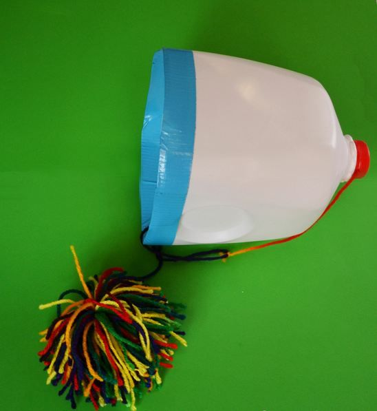 Pom Pom Toss - another pinner wrote this was amazing, my daughter and her friend loved this!!!  This would be great for eye hand coordination  and working the motor skills
