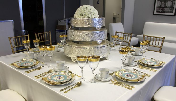 Ivory Satin Table Linen, Regal Gold Crystal Glassware, Regal Gold Flatware, Gold Band Dinner Plate, Gold Satin Napkin, Blue Vintage Marie Dessert Plate, Gold Band Tea Cup & Saucer, Gold Chiavari Chair & Cake Bases (as centrepiece) } Chair-man Mills  Photography by: Debbie Kriz