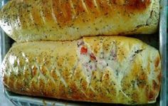 O Pão Pizza é um pão enrolado e recheado delicioso e fácil de fazer. Faça para o lanche dos seus familiares e surpreenda-os com a maciez e o sabor dessa re