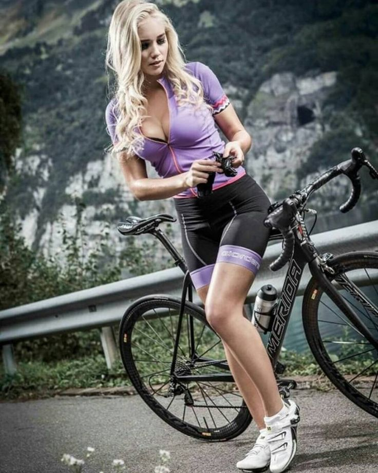 Sexy and beautiful woman with a bicycle in the tropical garden stock photo
