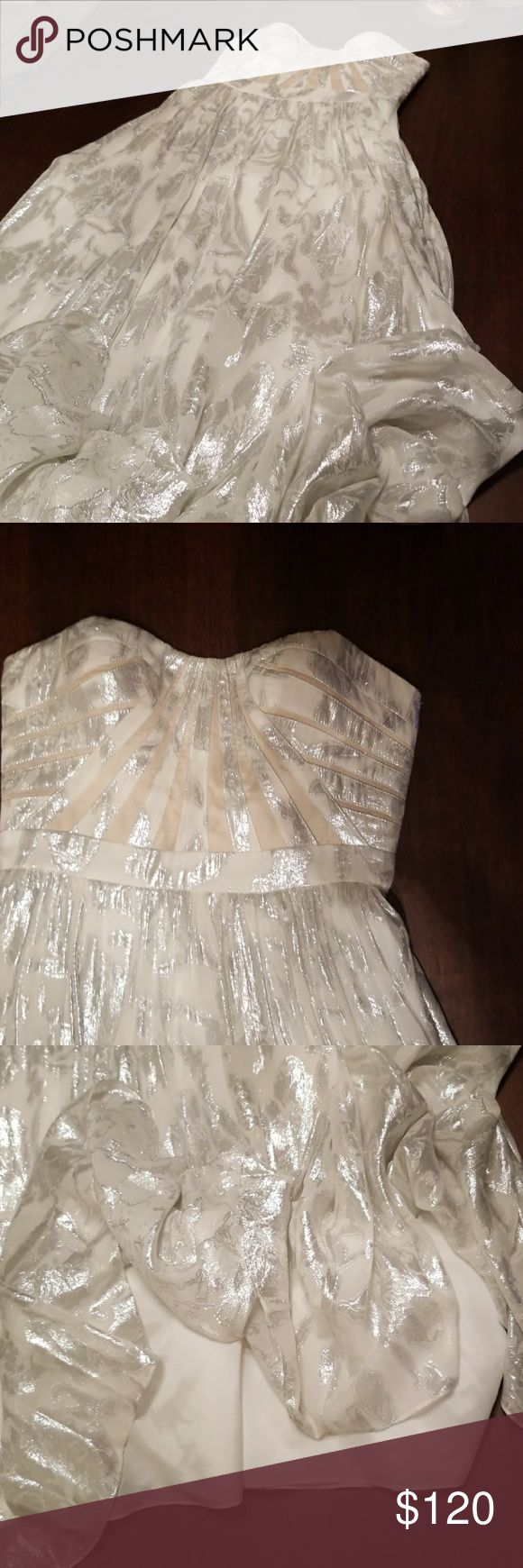 """Beautiful long strapless gown Strapless 70% silk white and 30 % metallic silver print long lined gown (4ft and 6"""" in length) size 8. Great for prom, wedding or any black tie affair. Aidan Mattox Dresses Prom"""