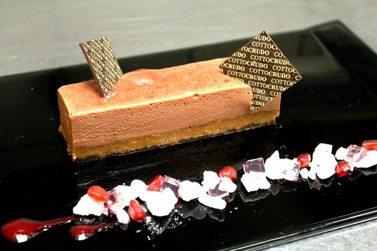 Valrhona chocolate mousse cake with pink champagne jelly and pomegranate