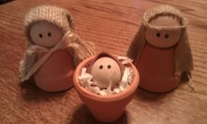 "Nativity Craft ...  Handmade nativity includes baby Jesus, Mary and Joseph.  Clay pots are left natural – not painted. Burlap is used for headdress.  Made from 1 1/2"" clay pots 1 1/2 "" wooden balls are used for the heads of Mary and Joseph. 1"" wooden balls form baby Jesus Height is approximately 3"". by marcia"