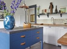 Country-Style Kitchen with Blue Painted Island