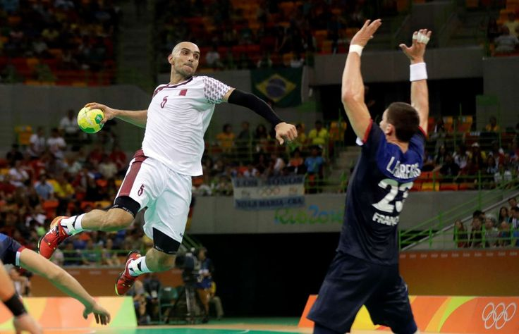 In flight moves:    Qatar's Marko Bagaric, left, tries to score past France's Ludovic Fabregas during a men's handball match on Aug. 9.