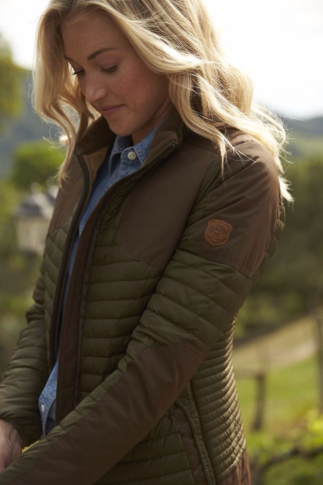 green gilet jacket with brown patch