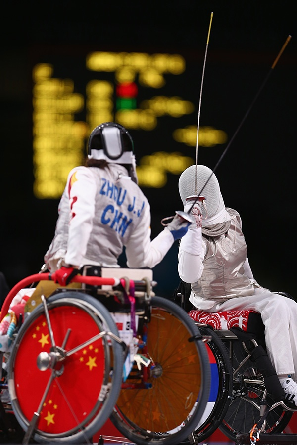 Lludmila Vasileva (R) of Russia in action against Jingjing Zhou (L) of China in the Women's Individual Foil Cat B Preliminaries of the Wheelchair Fencing on day 6 of the London 2012 Paralympic Games at ExCel on September 4, 2012 in London, England. (Photo by Michael Steele/Getty Images)