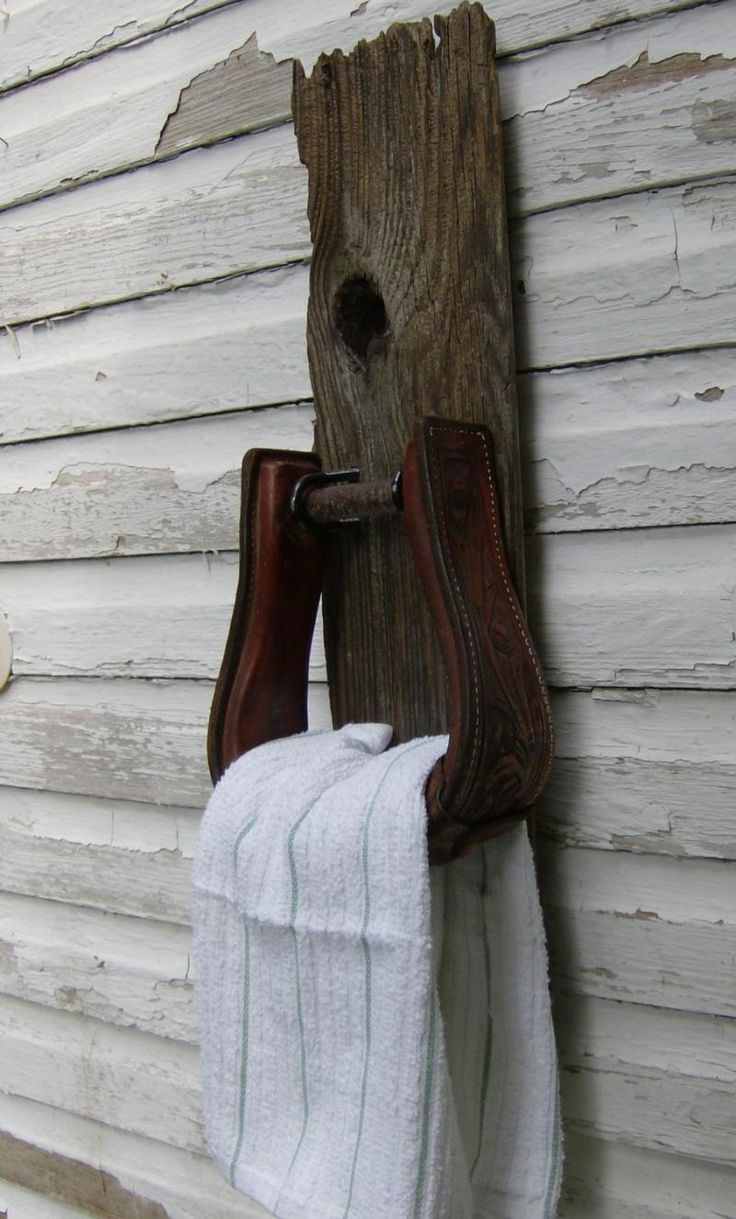 Western Towel Holder made from salvaged wood and a saddle stirrup by DesignsinGrain on Zibbet
