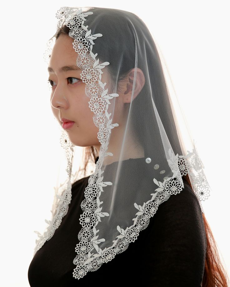 This is a brilliant and luxurious veil. 5mm Cubic Zirconia crystals are attached by hand in the center of luxury lace flower.  The delicate lace on the periphery is beautiful.  It is more glittering than you see in the photos.