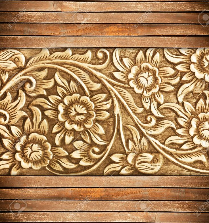 Pattern of wood frame carve flower on background