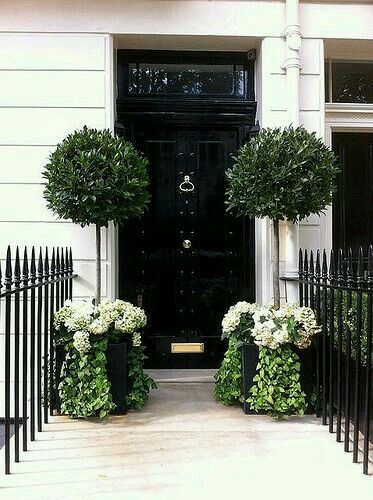 Co Co's Collection : Formal garden # structure # roses # boxwood Formal entry with matching topiary