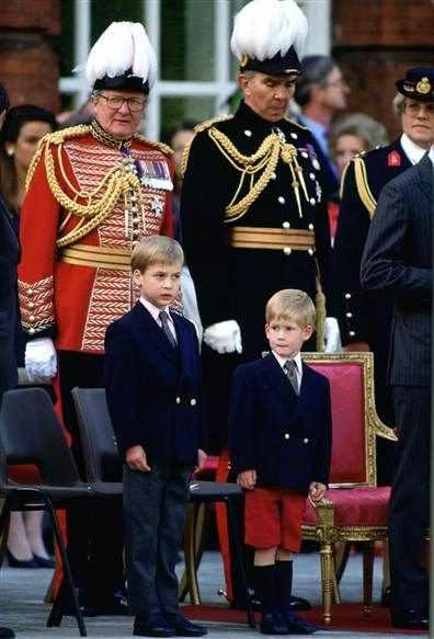 Prince William, 7, and Prince Harry, 4, watch the Beating Retreat Parade at Kensington Palace in June 1989