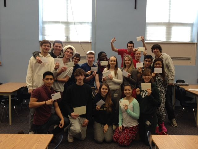 Ms. Bouttell's Grade 12 History Class writing personal letters with paper and pen.