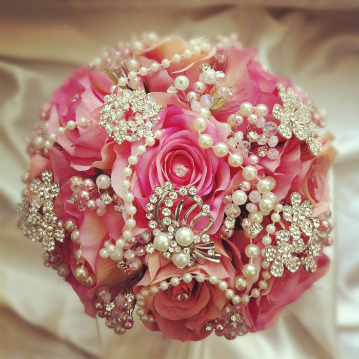 Would love these white pearls and brooches on a purple bouquet of silk flowers.