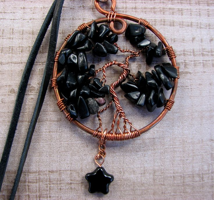 black jasper a.k.a. blackstone tree of life on a black suede cord. has been charged under the light of the last lunar eclipse.