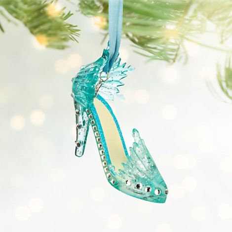 Cold Feet - Let it go on your holiday tree and this Elsa Shoe Ornament will give your holiday decorations a foot up. Detailed in icy blue resin, the Frozen ornament is encrusted with dazzling blue jewels.