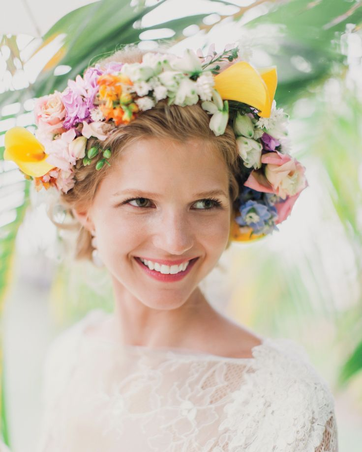 This bride incorporated the tropical colors of her island wedding into her bridal style with a bright band of blooms including mini calla lilies, lisianthus, and freesia.
