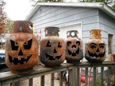 Plasma cutting halloween pumpkins faces out of empty helium tanks